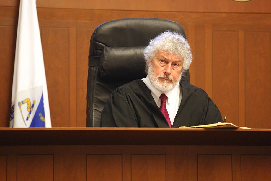 Judge Raymond Dougan was accused of judicial misconduct by the Suffolk district attorney.
